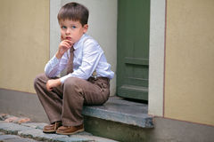 Portrait of a little boy having relax outdoors Stock Image