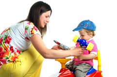 The portrait of a little boy and his mother. Playing with toys Royalty Free Stock Image
