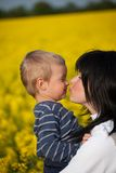 Portrait of a little boy with his mother. Royalty Free Stock Image