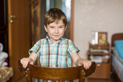 Portrait of a little boy in his room. Happy. Royalty Free Stock Photography