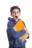 Portrait of little boy holding copybooks Stock Photos
