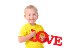 Portrait of little boy holding inscription Royalty Free Stock Photo