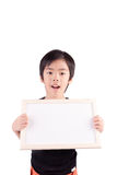 Portrait of a little boy holding a whiteboard Royalty Free Stock Photo