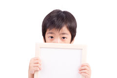 Portrait of a little boy holding a whiteboard Stock Image