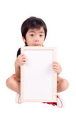 Portrait of a little boy holding a whiteboard Royalty Free Stock Images