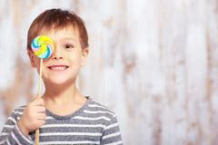 Portrait of little boy with a lollipop Royalty Free Stock Photos