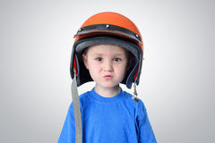 Portrait of a little boy in a motorcycle helmet Royalty Free Stock Images