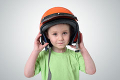 Portrait of a little boy in a motorcycle helmet Royalty Free Stock Image