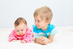 Portrait of little boy with newborn sister Stock Photo