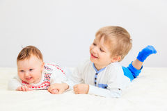 Portrait of little boy with newborn sister Stock Image