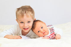 Portrait of little boy with newborn sister Stock Images