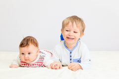 Portrait of little boy with newborn sister Royalty Free Stock Photos