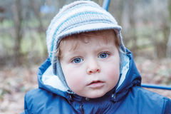 Portrait of little boy of one year in blue clothes outdoor. Royalty Free Stock Image