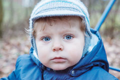 Portrait of little boy of one year in blue clothes outdoor. Stock Photo