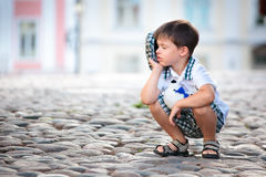 Portrait of a little boy outdoors. In city Royalty Free Stock Image