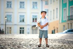 Portrait of a little boy outdoors in city Royalty Free Stock Image