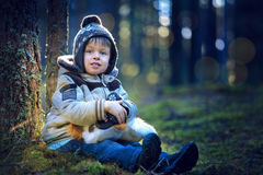 Portrait of little boy outdoors on cold day. Portrait of cute little boy with toy in forest on cold winter day Stock Photos