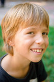 Portrait of little boy outdoors. In public park Royalty Free Stock Images