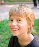 Portrait of little boy outdoors. In public park Stock Photography