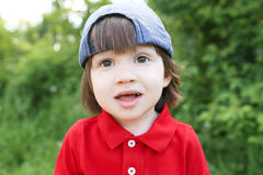 Portrait of little boy outdoors in summer Stock Images