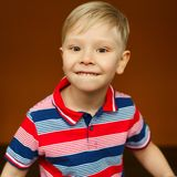Portrait of little boy over yellow background Stock Photo