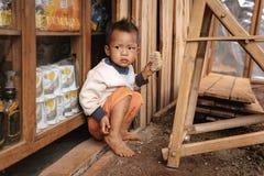 Portrait of little boy from Padaung (Karen) hill tribe. Pan Pet, Myanmar - May 25, 2016: Rural life of poor Myanmar children in Karen tribe stock image