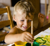 Portrait of little boy painting Royalty Free Stock Images