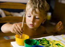 Portrait of little boy painting Stock Photography