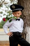 Portrait of the little boy in a peak-cap Royalty Free Stock Photography