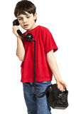 Portrait of little boy on the phone Stock Photography