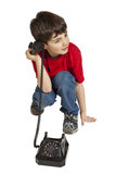 Portrait of little boy on the phone Stock Images
