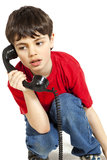 Portrait of little boy on the phone Stock Image