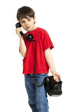Portrait of little boy on the phone Royalty Free Stock Images
