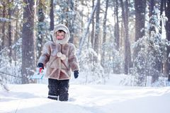 Portrait of little boy playing outdoors in winter forest Stock Photos