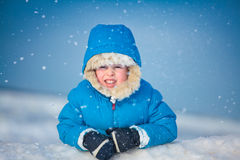 Portrait of a little boy playing in the snow Royalty Free Stock Photo