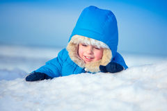 Portrait of a little boy playing in the snow Royalty Free Stock Images