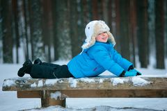 Portrait of a little boy playing in winter forest Royalty Free Stock Image