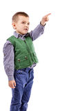Portrait of a little boy pointing up Stock Photo