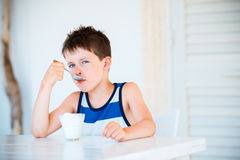Portrait of little boy refuses to eat delicious yogurt Stock Photography
