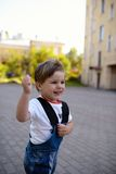 Portrait of little boy running and smiling Stock Image