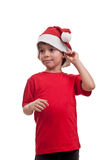 Portrait of little boy in Santa Claus hat isolated on white background Royalty Free Stock Images