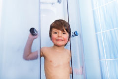 Portrait of little boy in shower cabin washing Stock Image