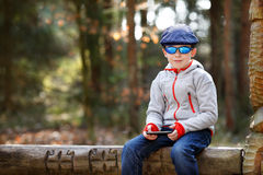 Portrait of little boy sitting on a bench Royalty Free Stock Photo