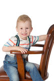 Portrait of little boy sitting in a chair Royalty Free Stock Photography