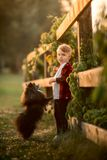 Portrait of a little boy with small dog in the park Royalty Free Stock Image