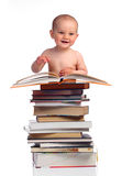 Portrait of a little boy with a stack of books Royalty Free Stock Photography