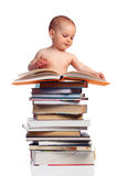 Portrait of a little boy standing behind a stack o Royalty Free Stock Images