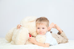 Portrait of little boy with teddy bear at home Stock Photos