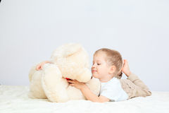 Portrait of little boy with teddy bear at home Royalty Free Stock Photography