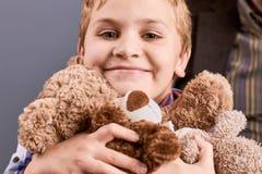 Portrait of little boy with teddy bear. Stock Image